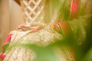 bride ritual Indian wedding wearing assorted bangles