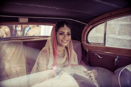 bride in a vintage car for her traditional Indian wedding Mauritius