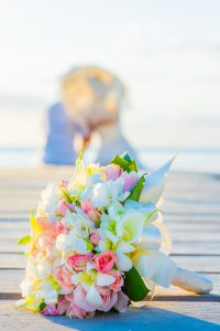 bouquet of flower nicely displace on a jetty where couple are having a romantic moment
