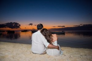 honeymooners having good time while watching the sunset