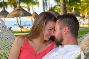 mauritius honeymoon photographer shooting couple sitting on a hammock by the seaside