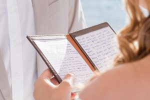 bride saying reading poem to groom on ceremony