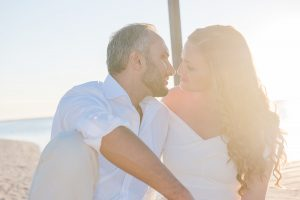 mauritius honeymoony couple kissing by golden hour in a romantic mood