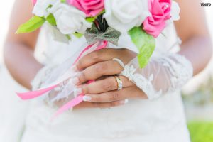 wearing a wedding rings in the fourth finger for a woman meaning and endless love and her bouquet of flower