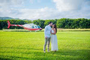 couple kissing tenderly and Mauritius helicopter in the background