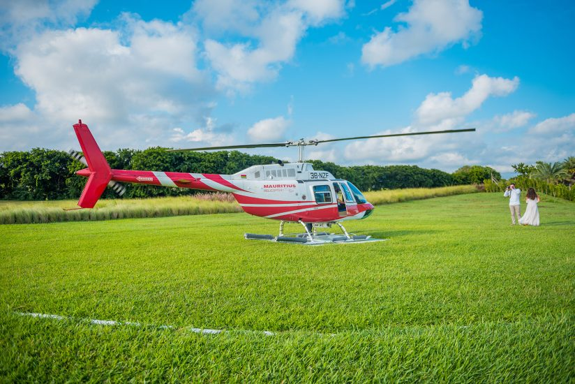 Mauritius helicopter landing and couple waiting to go for a ride