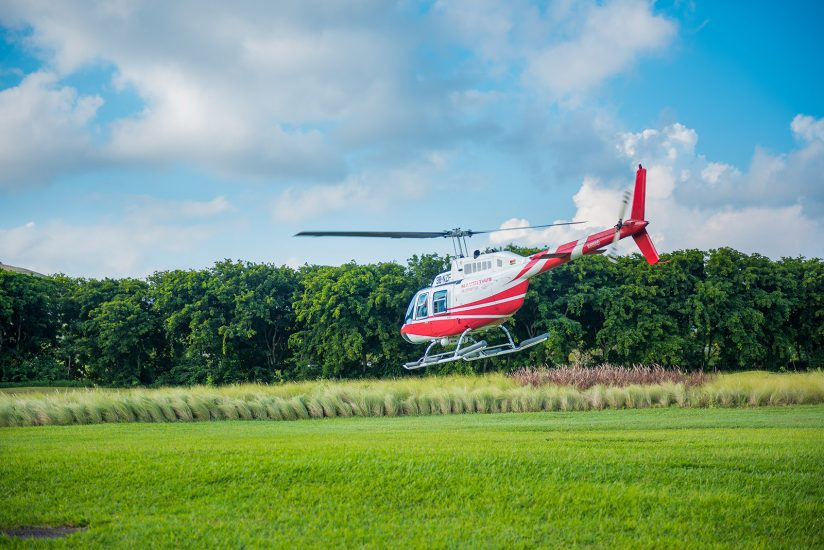 Mauritius helicopter flying together with couple