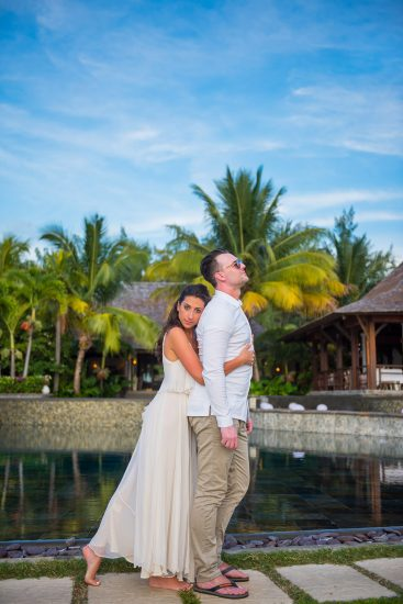 bride hug groom from back with a beautiful coconut trees in the background