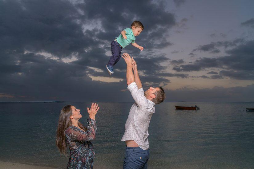 Daddy catch little boy in the air